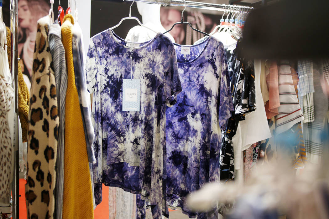"""A """"regular"""" size blouse, left, hangs next to an identical plus size blouse at the Hay ..."""