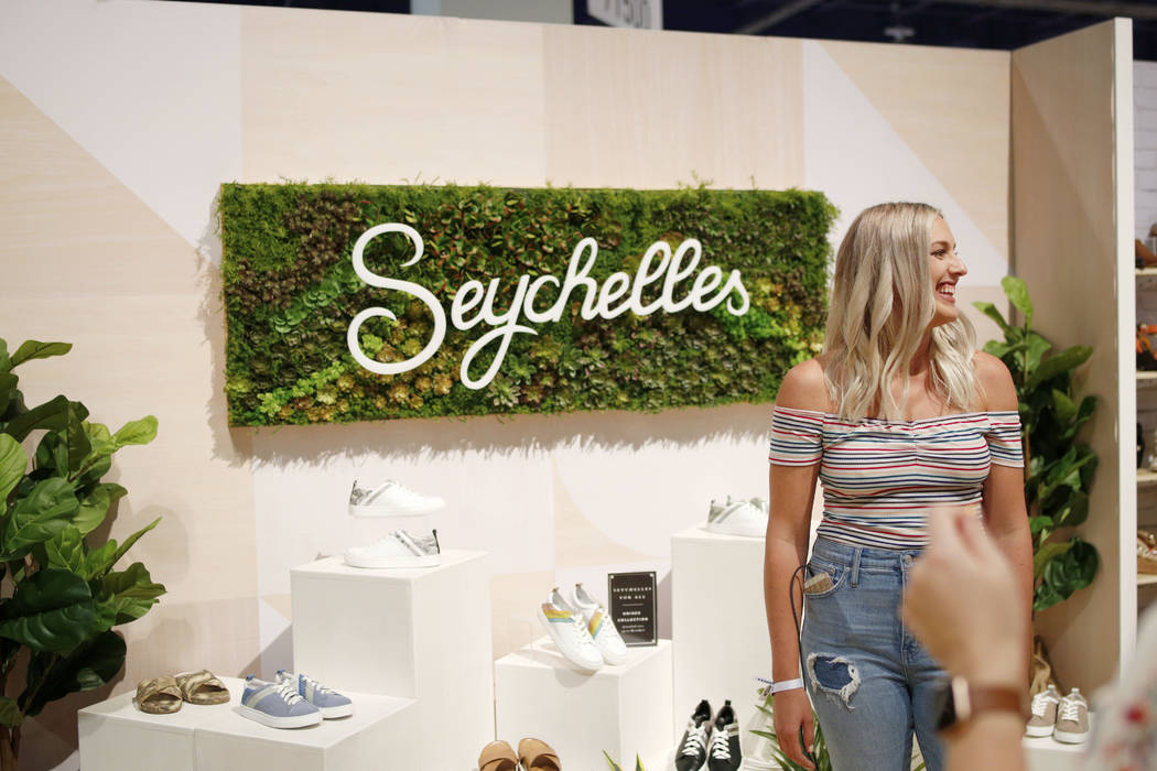 Seychelles designer Stephanie Boda stands in front of the company's first unisex designs coming ...