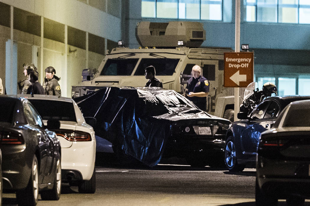 A California Highway Patrol vehicle is covered with a tarp outside the emergency room entrance ...