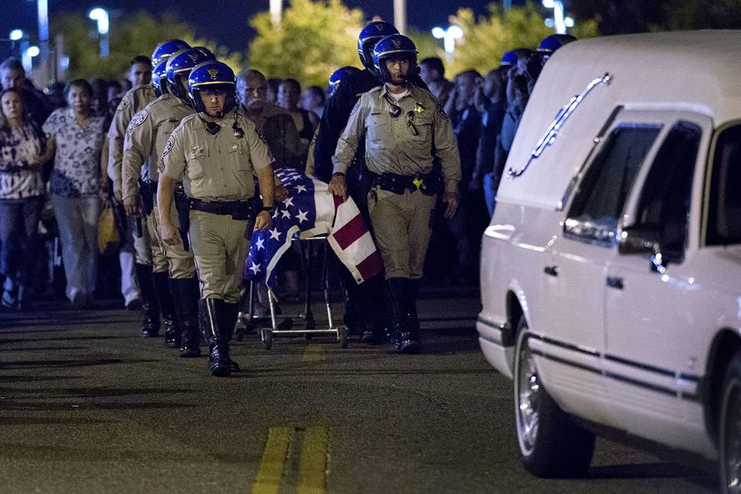 The casket of slain CHP officer Andre Moye is transported to a hearse from the Riverside Univer ...