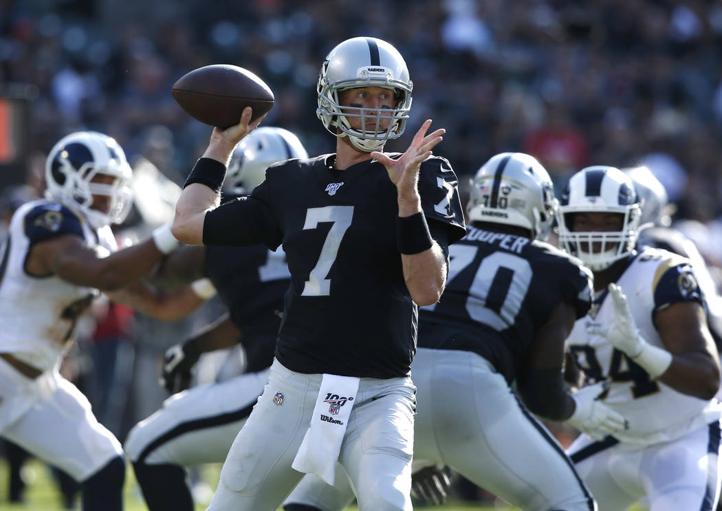 Oakland Raiders' Mike Glennon looks to pass against the Los Angeles Rams during the first half ...