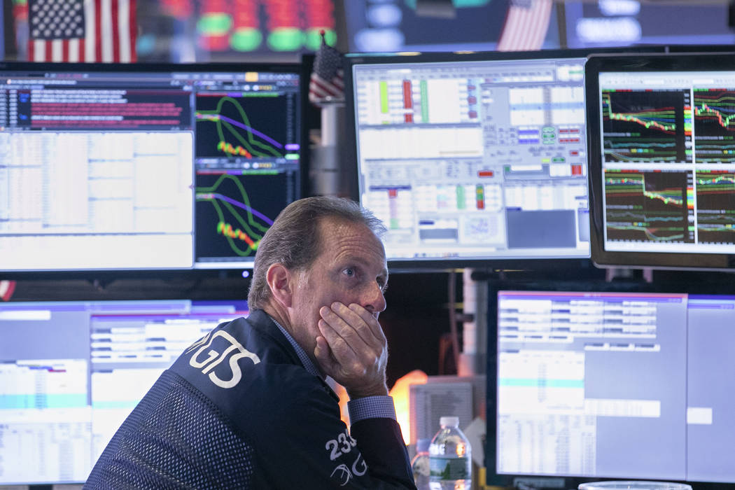 Specialist Glenn Carrel works at his post on the floor of the New York Stock Exchange, Wednesda ...