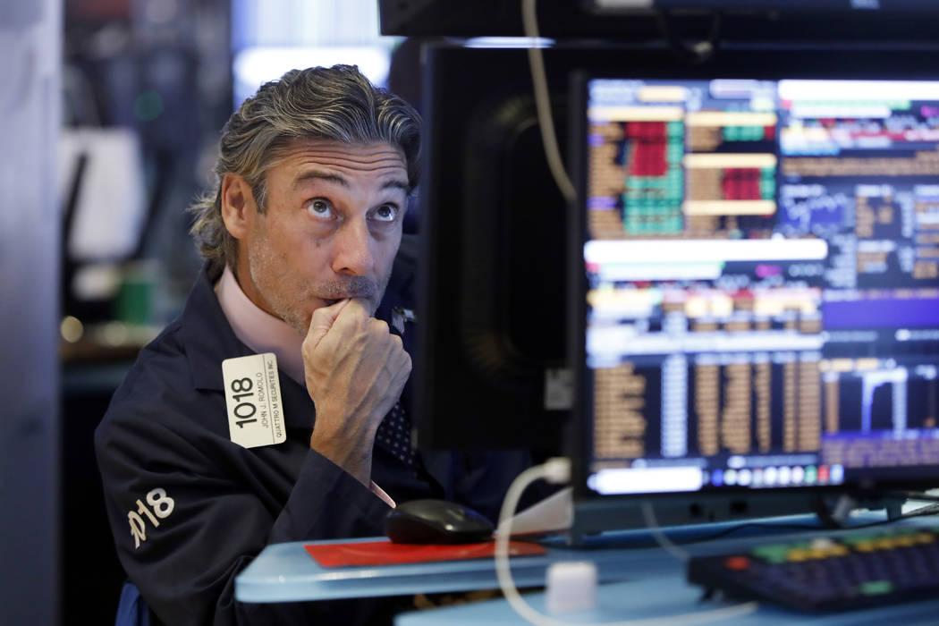 Trader John Romolo works on the floor of the New York Stock Exchange, Wednesday, Aug. 14, 2019. ...