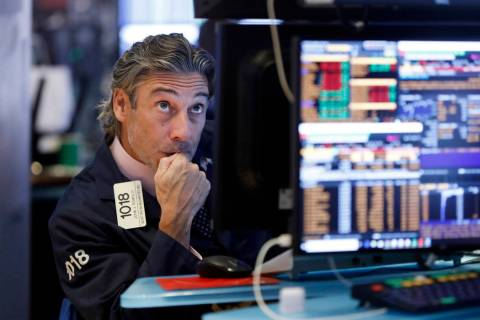 Trader John Romolo works on the floor of the New York Stock Exchange, Wednesday, Aug. 14, 2019. ...