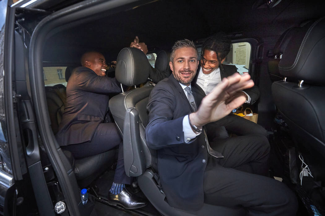 A$AP Rocky, background right, leaves the district court in Stockholm by car, after the third da ...