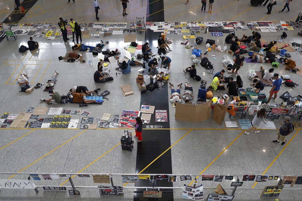 Protesters continue their sit-in rally at the airport in Hong Kong, Wednesday, Aug. 14, 2019. F ...