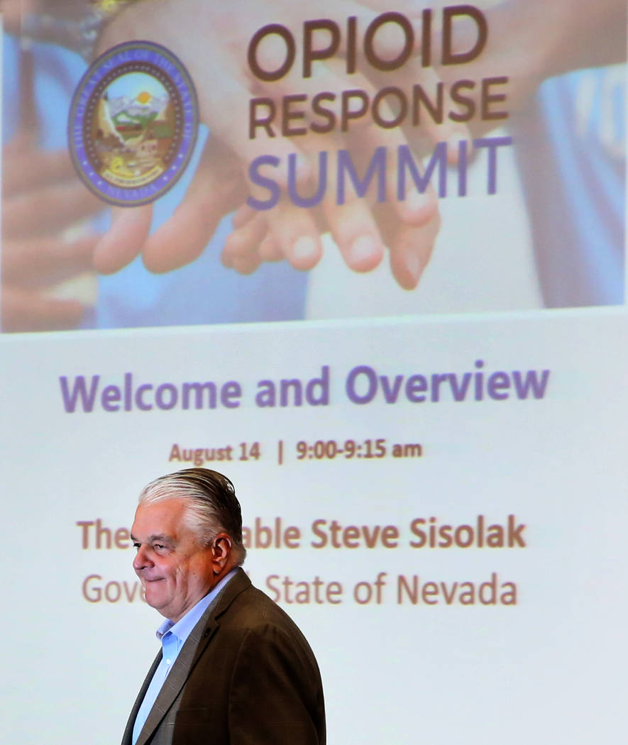 Gov. Steve Sisolak leaves the podium after speaking at the Nevada Opioid Response Summit on Wed ...