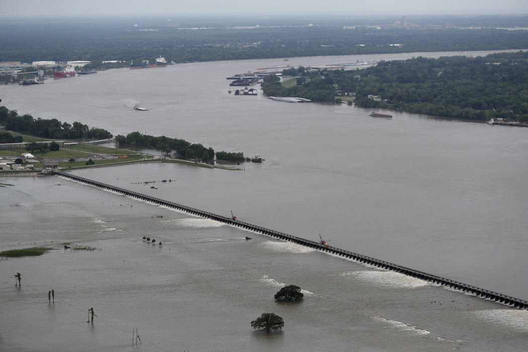File - In this May 10, 2019 file photo, workers open bays of the Bonnet Carre Spillway, to dive ...