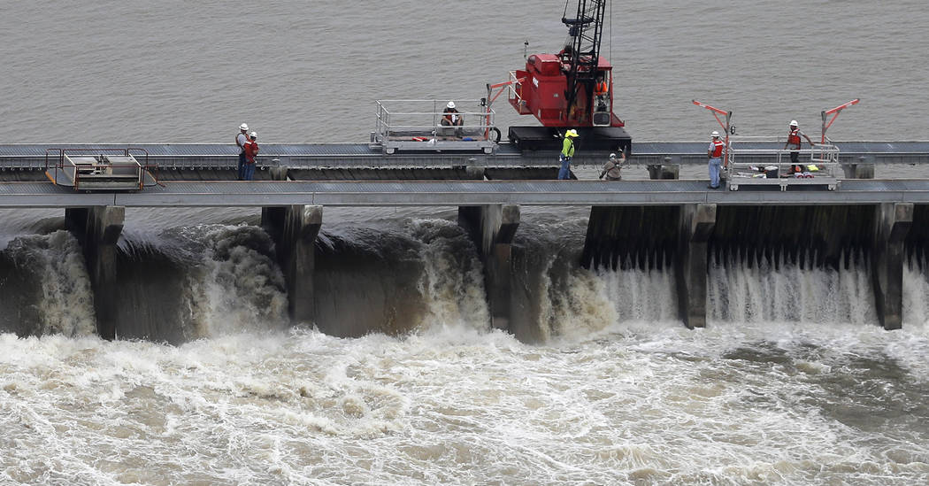 File - In this May 10, 2019, file photo, workers open bays of the Bonnet Carre Spillway, to div ...