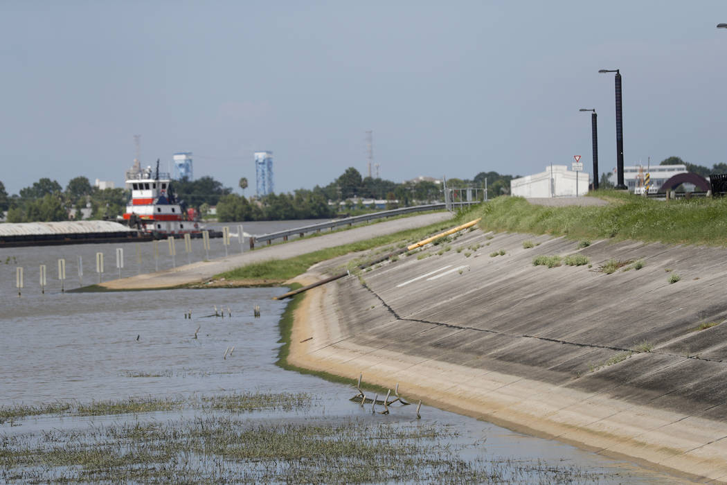 In this July 25, 2019, photo, Water lines and receding water are seen on the backside of the Mi ...