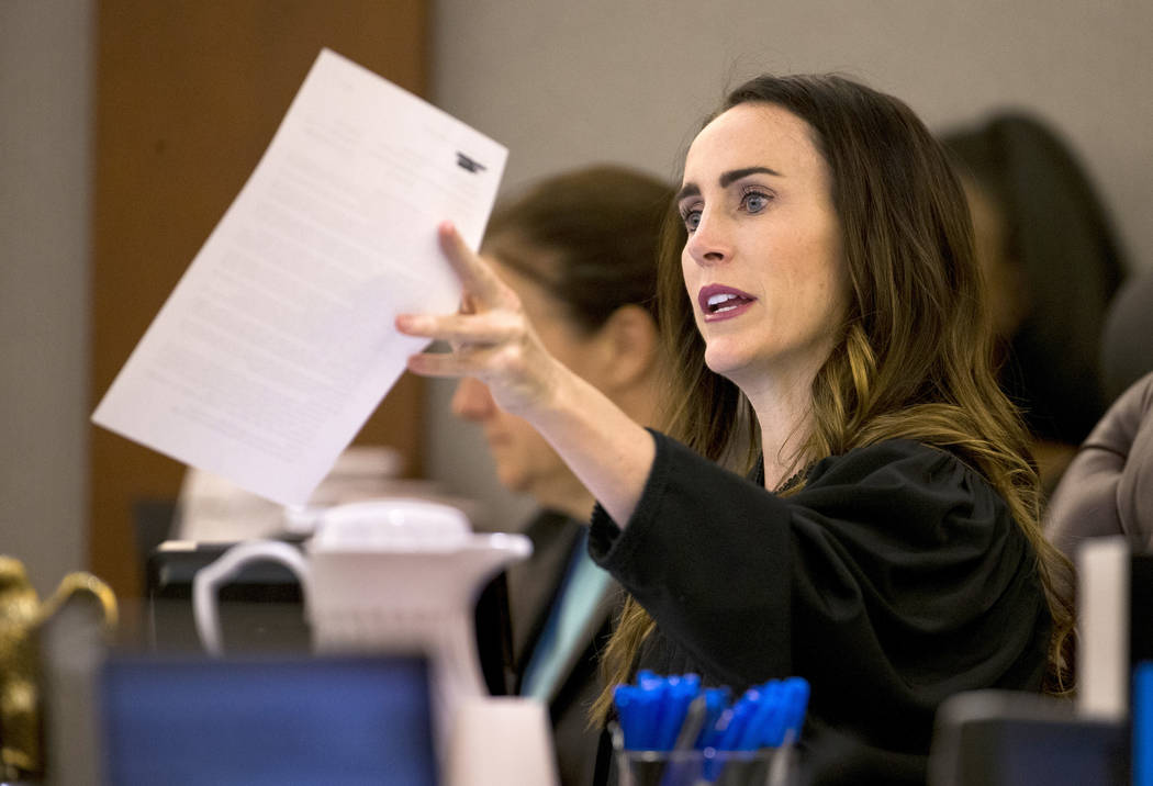 District Judge Jacqueline Bluth hands over some paperwork during sentencing for Andrew Arevalo ...