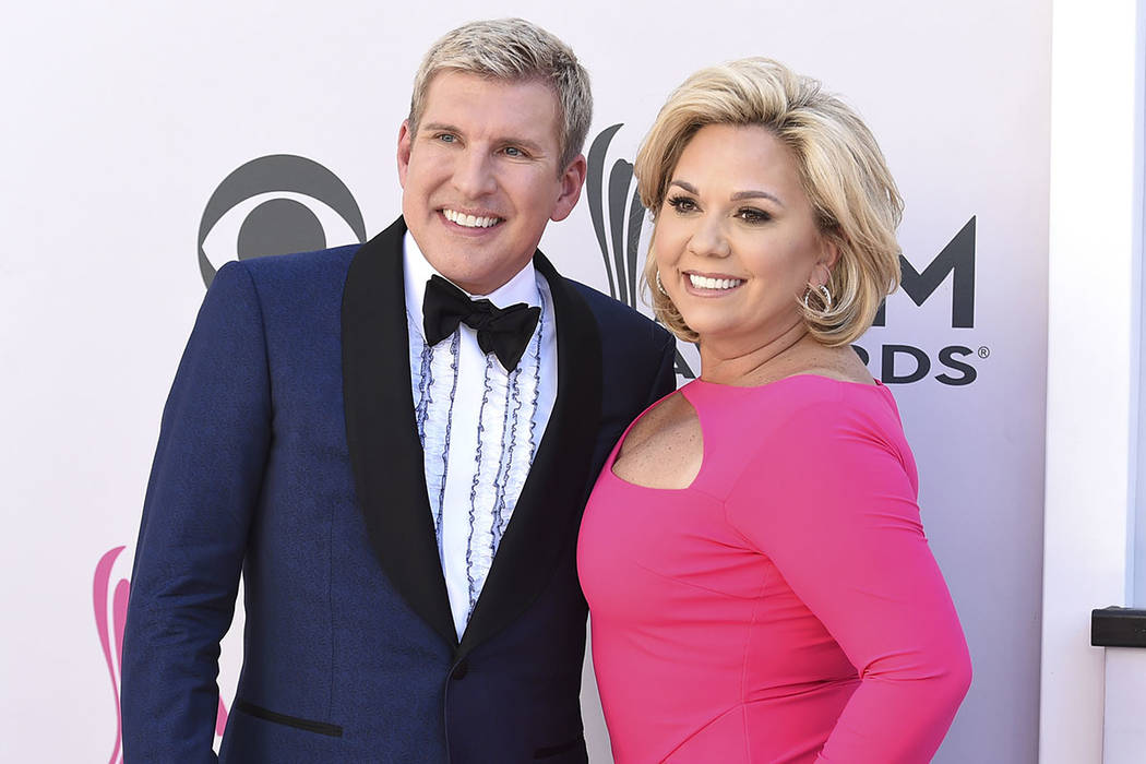 FILE-Todd Chrisley, left, and Julie Chrisley arrive at the 52nd annual Academy of Country Music ...