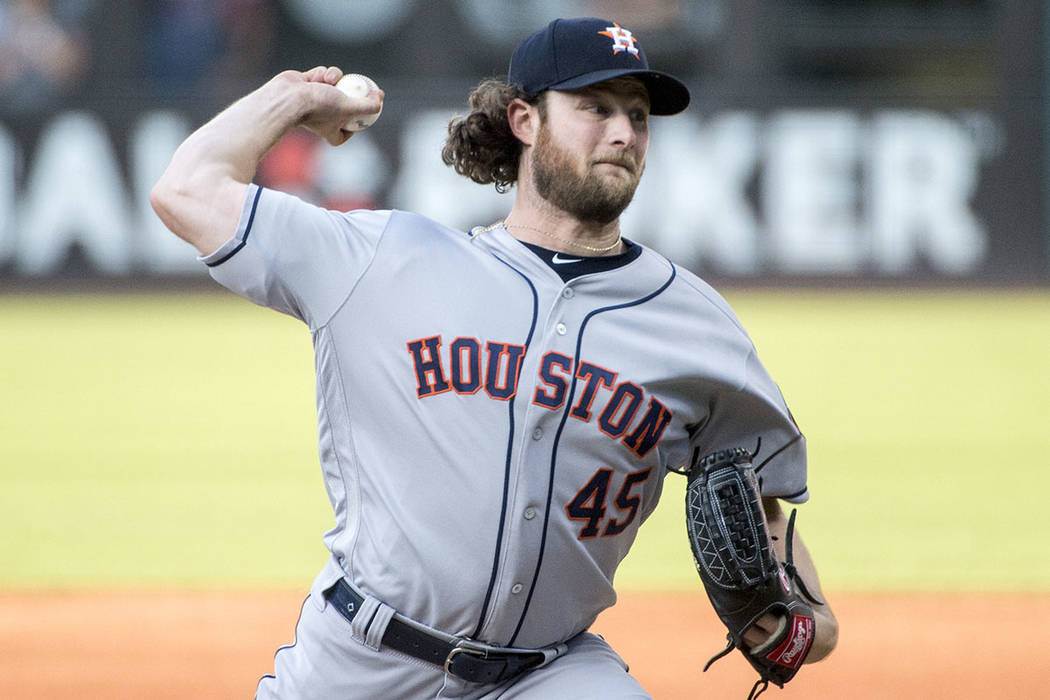 Houston Astros starting pitcher Gerrit Cole delivers against the Cleveland Indians during a bas ...