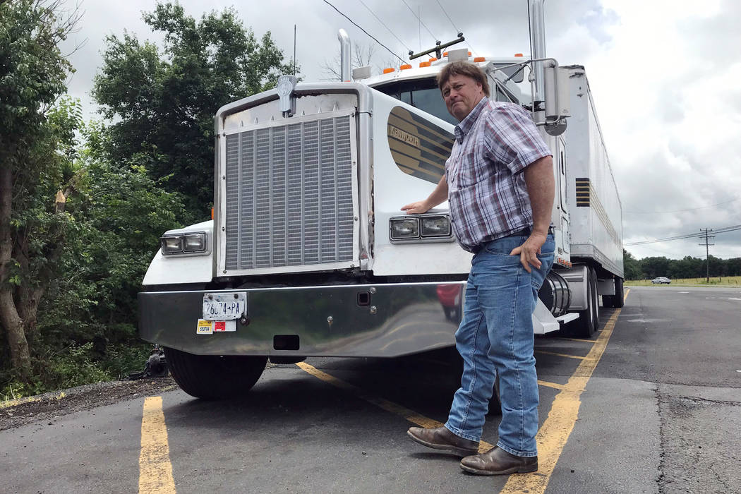 In this June 13, 2019 photo, truck driver Terry Button poses with his truck during at stop in O ...