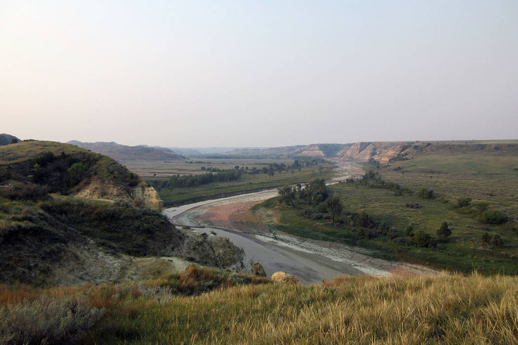 This Sept. 3, 2017 photo shows a curving river at Theodore Roosevelt National Park in Medora, N ...