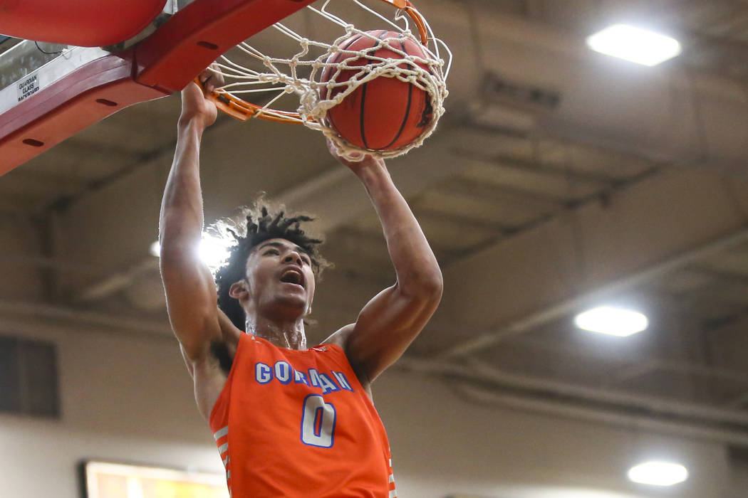 Bishop Gorman's Isaiah Cottrell (0) dunks over Findlay Prep's Alex Tchikou during the first hal ...