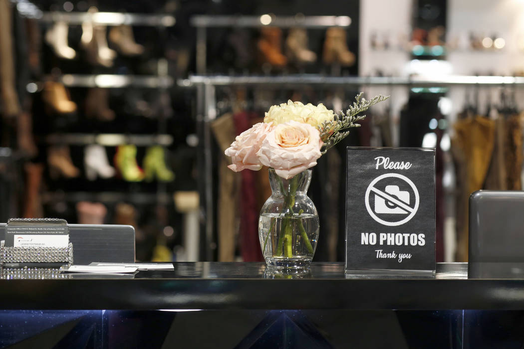 A sign prohibits photography of Legend Footwear Inc.'s exhibit and products on the Fast Fashion ...