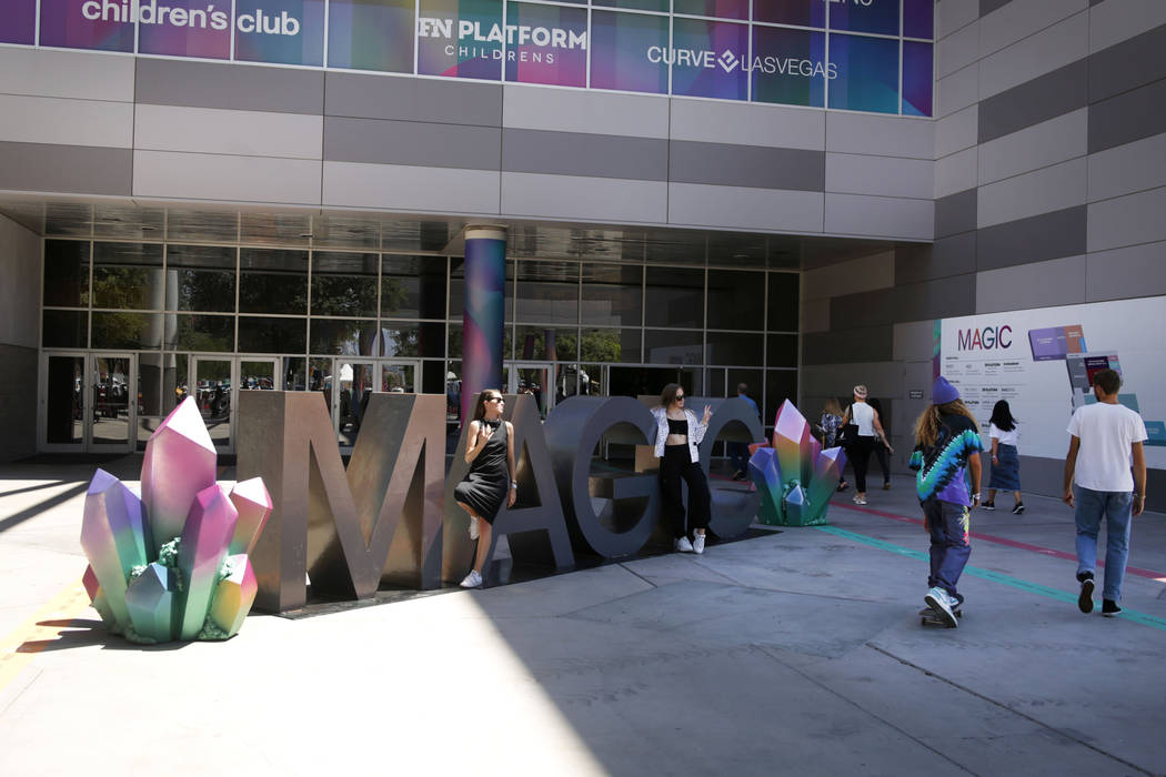 Attendees come and go during the third day of the MAGIC trade show at the Las Vegas Convention ...