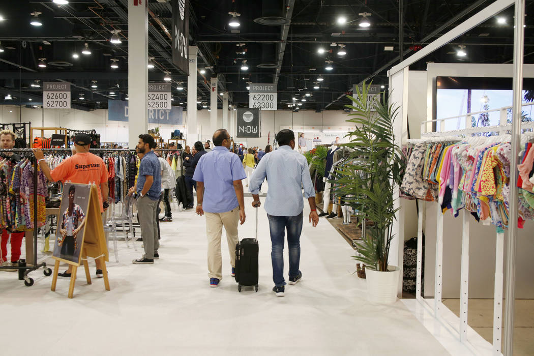 Attendees walk the show floor during the third day of the MAGIC trade show at the Las Vegas Con ...