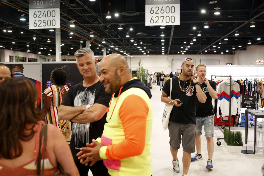 Attendees walk the Project floor during the third day of the MAGIC trade show at the Las Vegas ...