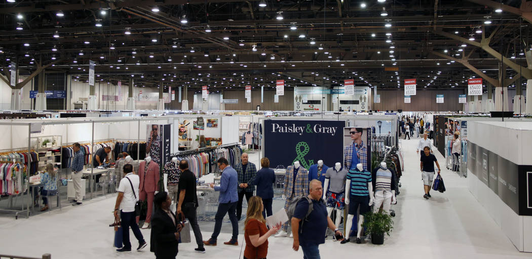 Attendees walk the Mens MAGIC floor during the third day of the MAGIC trade show at the Las Veg ...