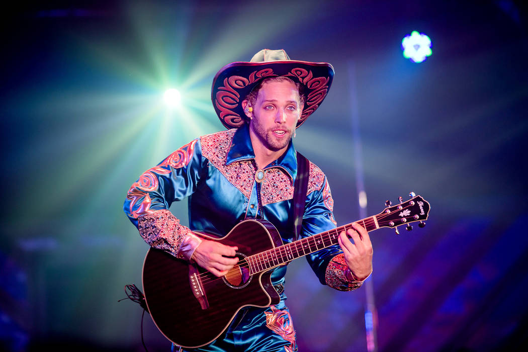 """Colin Cahill performs as Blue Jackson during a performance of """"Atomic Saloon Show"""" during its d ..."""