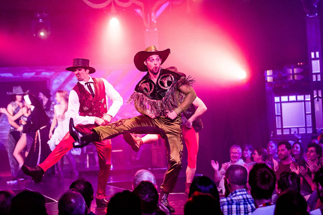 """Colin Cahill leads a show-closing cowboy jig in a performance of """"Atomic Saloon Show"""" during it ..."""