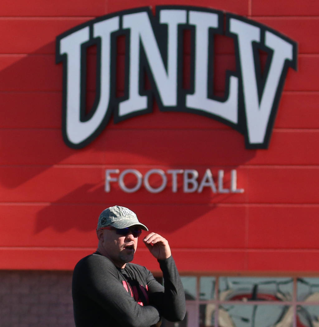 UNLV Rebels head coach Tony Sanchez watches his players during team practice on Tuesday, Aug. 1 ...
