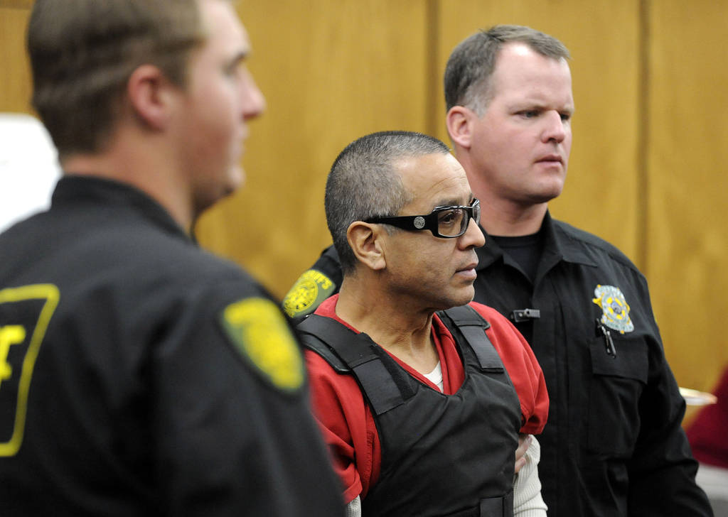 Vagos motorcycle gang member Ernesto Gonzalez is led from district court under heavy security i ...