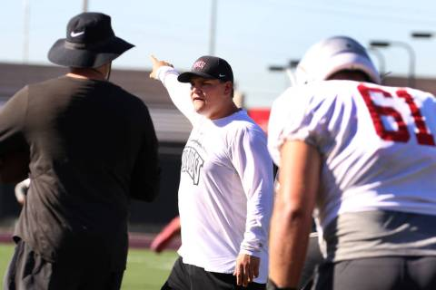UNLV Rebels graduate assistant coach Will Kreitler instructs his players during team practice o ...