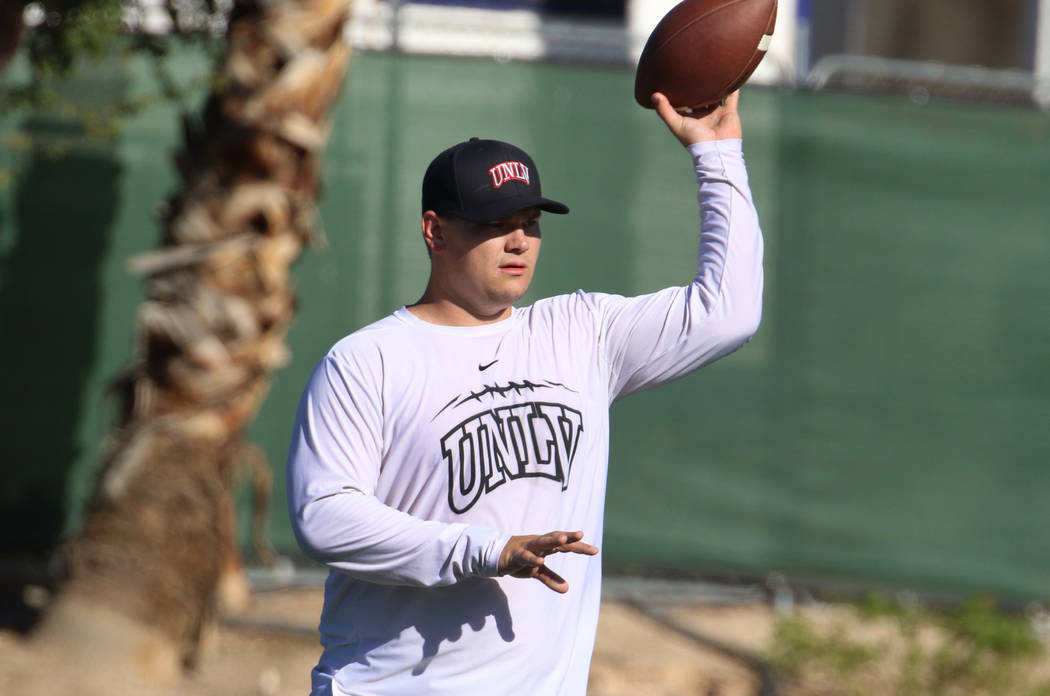 UNLV Rebels graduate assistant coach Will Kreitler prepares to pass the ball during team pract ...