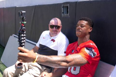UNLV football head coach Tony Sanchez, left, and linebacker Javin White (16), video log during ...