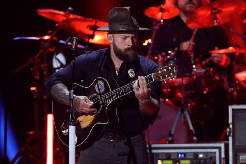 FILE - In this Wednesday, June 5, 2019 file photo Zac Brown performs at the CMT Music Awards in ...