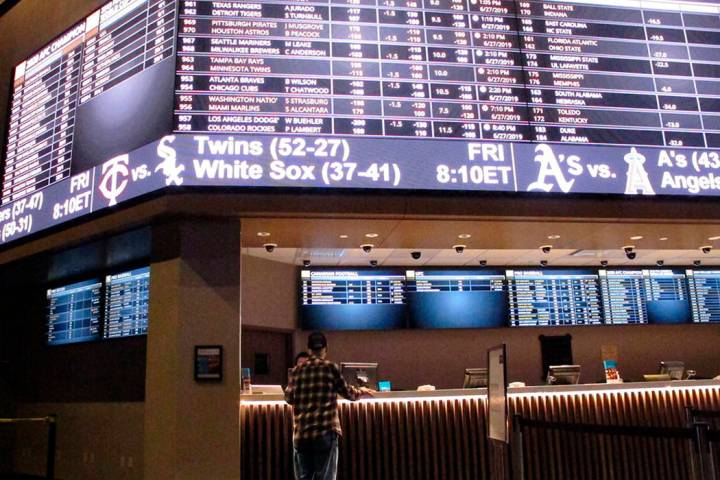 A customer ponders the odds at the new sportbook at Bally's casino in Atlantic City, N.J., in J ...