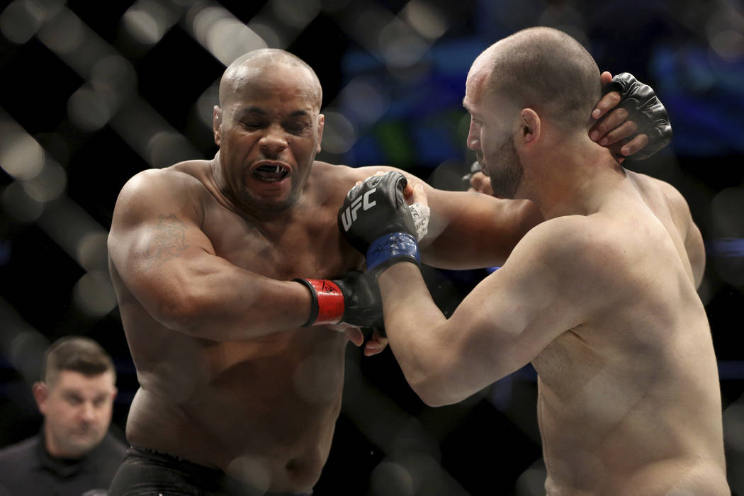 Daniel Cormier, left, exchanges blows with Volkan Oezdemir during a light-heavyweight champions ...