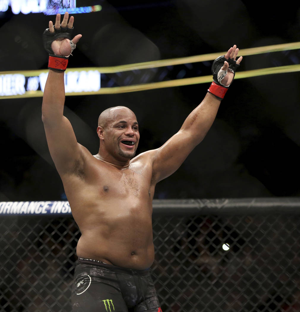 Daniel Cormier celebrates a win over Volkan Oezdemir in a light heavyweight championship mixed ...