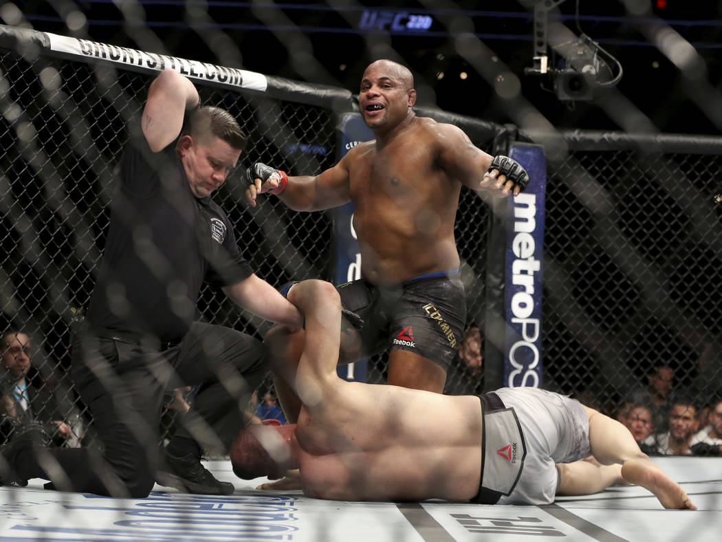 Daniel Cormier celebrates as the referee stops his light heavyweight mixed martial arts bout ag ...