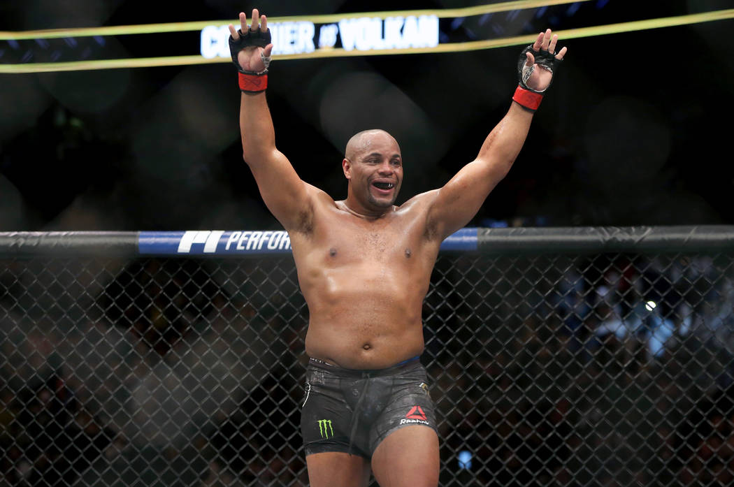 FILE - In this Jan. 20, 2018, file photo, Daniel Cormier celebrates a win over Volkan Oezdemir ...