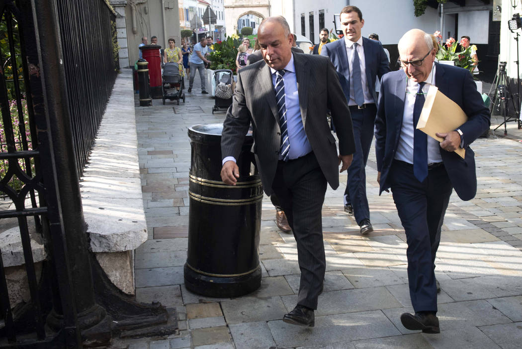 Attorney General for Gibraltar Michael Llamas, left, arrives at the court in the British territ ...