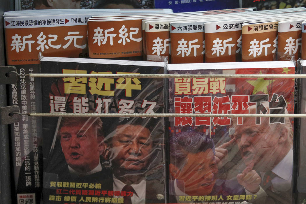 In a July 4, 2019, photo, Chinese magazines with front covers featuring Chinese President Xi Ji ...