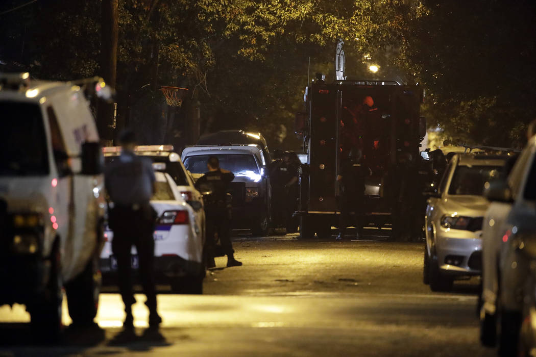 Authorities continue their investigation of a shooting where multiple police officers were shot ...