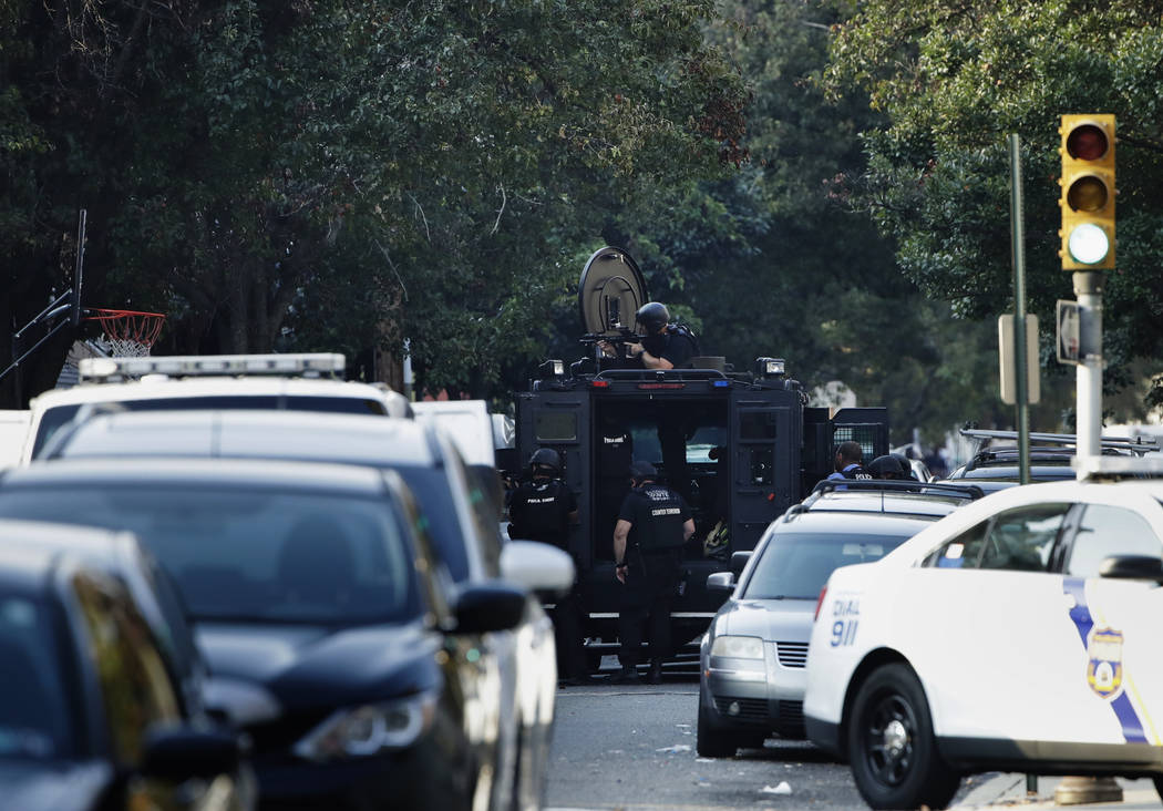 A massive police presence is set up outside a house as they investigate an active shooting situ ...
