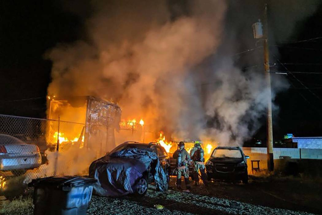 A shed and vehicles burn at B&B Auto Sales, 3800 Vegas Drive, early Thursday morning, Aug. 15, ...
