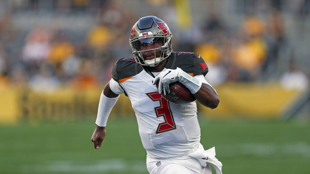 Tampa Bay Buccaneers quarterback Jameis Winston (3) scrambles during the first half of an NFL p ...