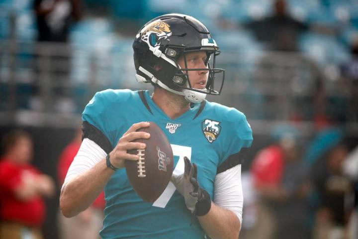 Jacksonville Jaguars quarterback Nick Foles (7) warms up before the first half of an NFL presea ...