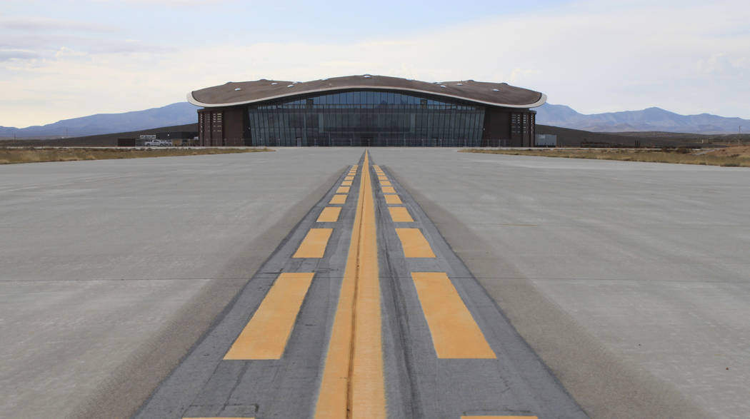 FILE - This Dec. 9, 2014 photo shows the taxiway leading to the hangar at Spaceport America in ...