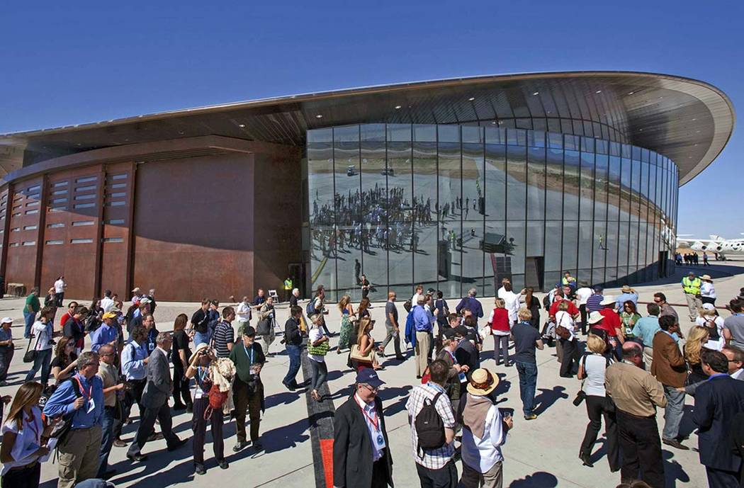 In a Oct. 17, 2011, file photo, guests stand outside the new Spaceport America hangar in Upham, ...