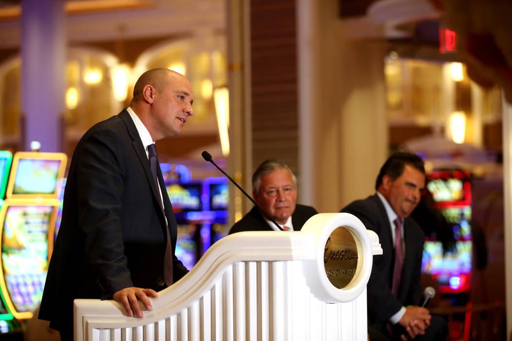 Wynn Resorts CEO Matt Maddox, from left, and Bob DeSalvio, president of Encore Boston Harbor, a ...