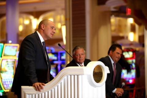 Wynn Resorts CEO Matt Maddox, from left, and Bob DeSalvio, president of Encore Boston Harbor, a ...