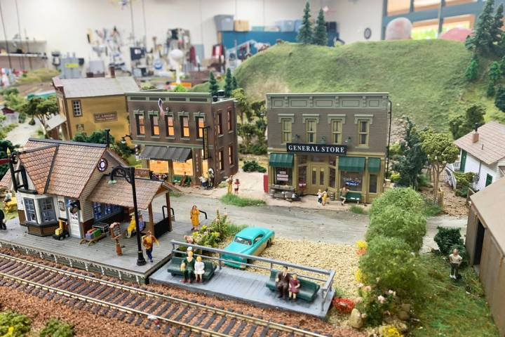 The model town that sits in the middle of the club's meeting room is filled with a series of ri ...